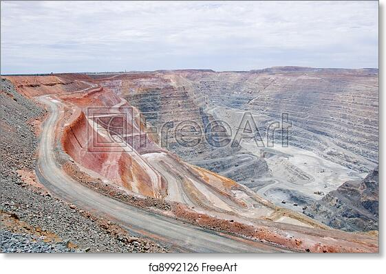 Free art print of Big mine pit with little dump trucks and reddish soil
