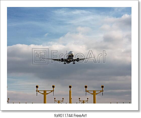 Free art print of Passenger plane on final approach, with landing lights in  view