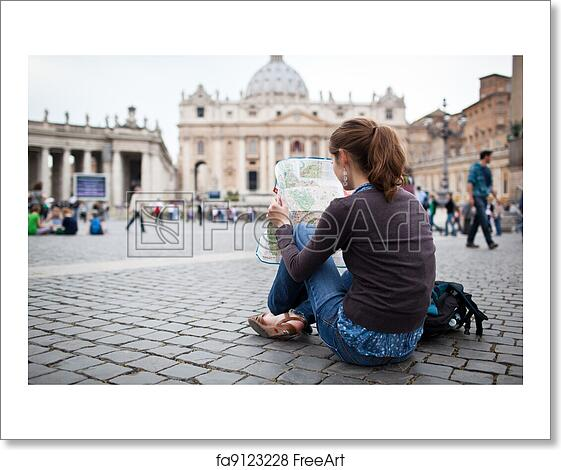 Free art print of Pretty young female tourist studying a map at St  Peter's  square in the Vatican City in Rome