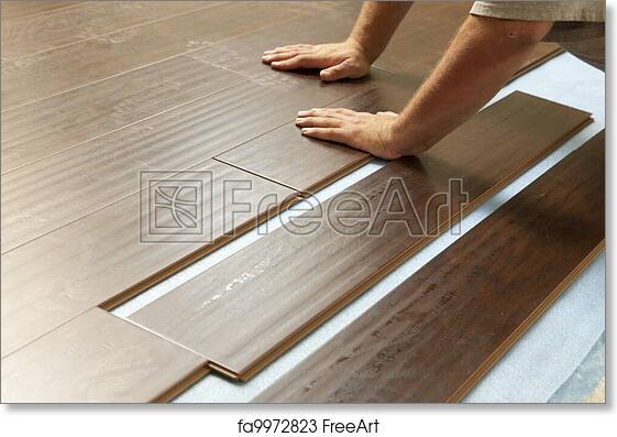 Free Art Print Of Man Installing New Laminate Wood Flooring Man